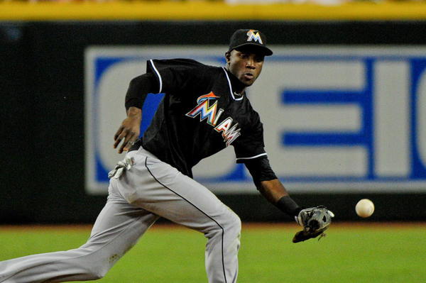 June 17, 2013; Phoenix, AZ, USA; Miami Marlins shortstop Adeiny Hechavarria (3) fields the ball during the second inning against the Arizona Diamondbacks at Chase Field. Mandatory Credit: Matt Kartozian-USA TODAY Sports ORG XMIT: USATSI-122422