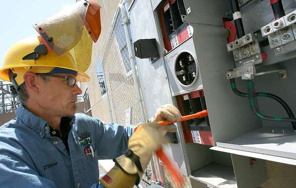 A GWP worker installs a smart meter (File Photo)