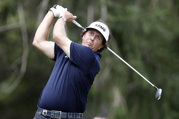 Phil Mickelson tees off on the 16th hole during the final round of the 95th PGA Championship on Sunday.