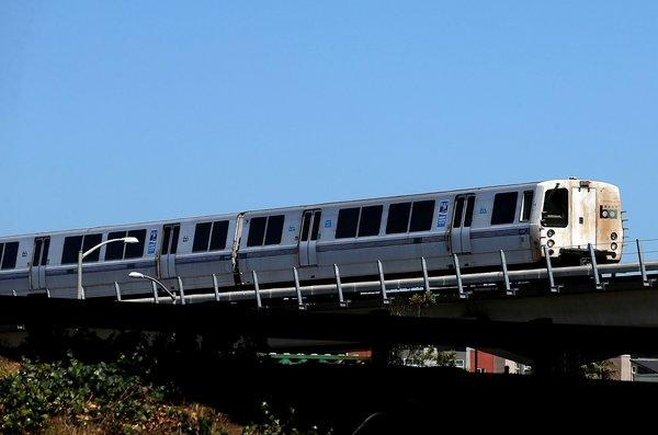 A Bay Area Rapid Transit (BART) train travels toward downtown Oakland.