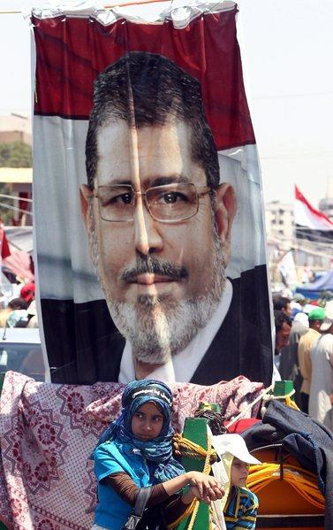 Supporters of the Muslim Brotherhood attend a protest Sunday in support of ousted Egyptian President Mohamed Morsi outside the Rabaa al Adawiya mosque in Cairo.