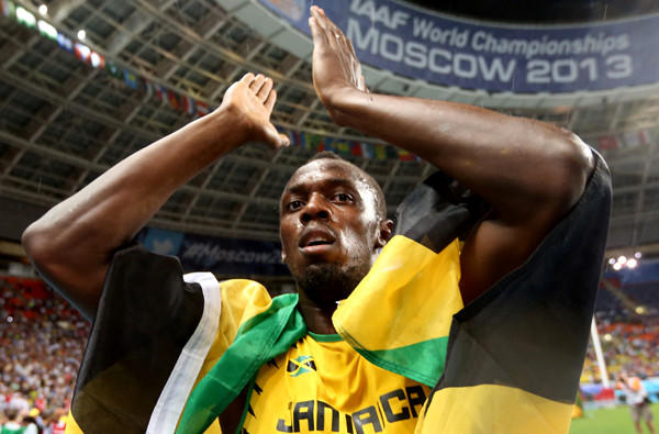 Usain Bolt applauds the crowd after winning the 100-meter dash at the world championships on Sunday in Moscow.