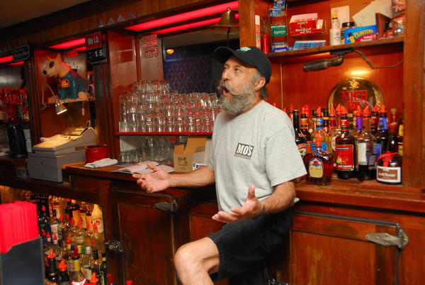 Bartender John Madrid entertains the morning patrons at Guthrie's Alley Cat Alley Cat on Wall Street in Bakersfield.