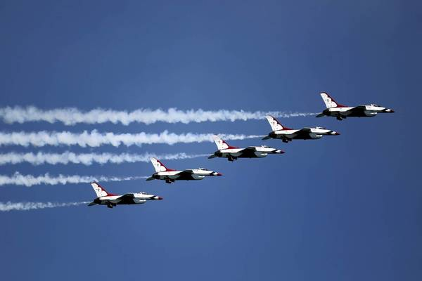 The Air Force Thunderbirds fly over Lake Michigan in Chicago on Aug. 19, 2011, while practicing for the Air & Water Show. The Thunderbirds aren't able to return this year because of federal cuts from sequestration. The city's air show booked six new acts to fill the void.