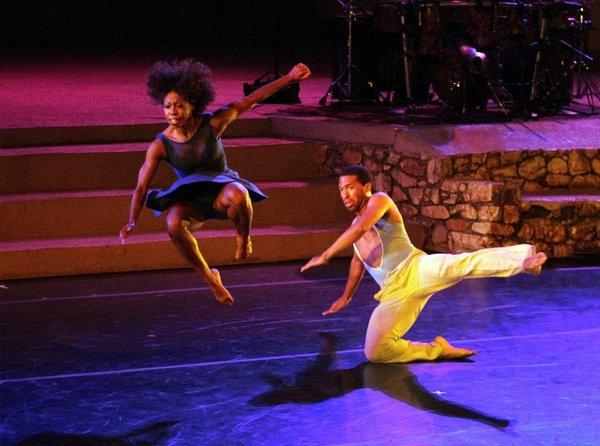 Khilea Douglass, left, and Micah Moch of the L.A.-based Lula Washington Dance Theatre perform Saturday night at the John Anson Ford Amphitheatre.