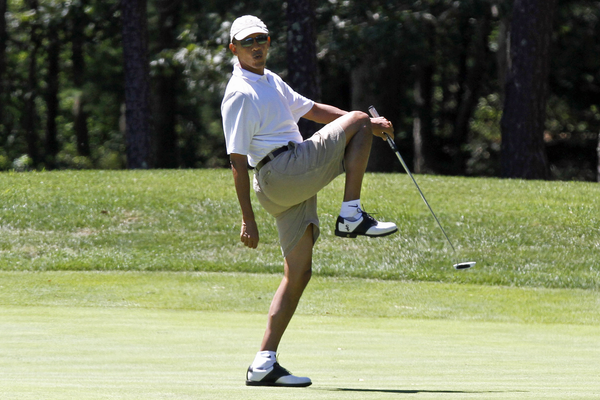 President Obama reacts as he misses a shot while golfing on the first hole at Farm Neck Golf Club in Oak Bluffs, Mass., on the island of Martha's Vineyard.