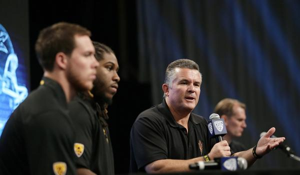 Arizona State Coach Todd Graham, right, speaks next to quarterback Taylor Kelly, left, and Will Sutton during the Pac-12 football media day in July. Graham has brought order to the Sun Devils' program.