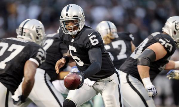 Oakland Raiders quarterback Terrelle Pryor hands off the ball during a preseason game against Dallas Cowboys on Friday. The former Ohio State standout says he's ready to make on-field contributions for the Raiders this season.