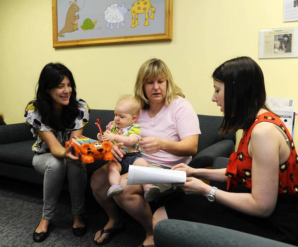 Lisa Feigenson, left, co-director of the lab for child development at the Johns Hopkins University, plays with 10 month old Lillian Gabor as her mother, Grechen Canova-Gabor holds her on her lap and speaks with graduate student Aimee Stahl, on right. Ms. Stahl was preparing to perform a perception test on the baby.