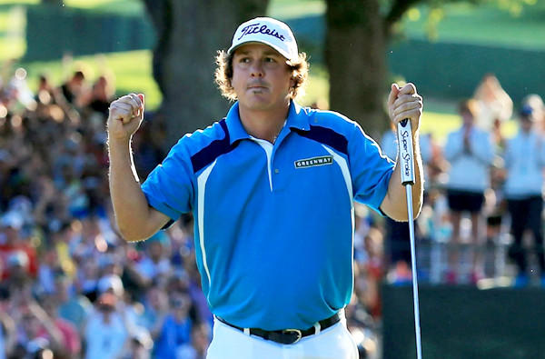 Jason Dufner reacts after tapping in his final putt at No. 18 to clinch the victory in the PGA Championship on Sunday at Oak Hill Country Club.