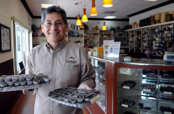 "Former broadcast executive Felix Bautista in his Schakolad chocolate shop in Davie. Bautista is among a growing number of ""second act"" careers among Baby Boomers in the region."