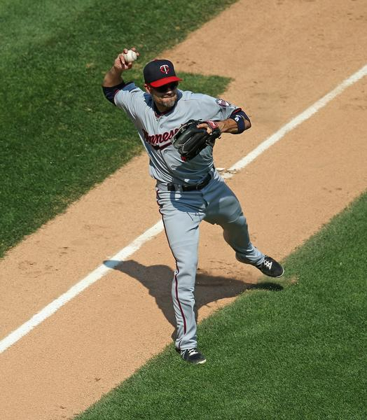 The Twins' Jamey Carroll throws out Alexei Ramirez in the 6th inning.