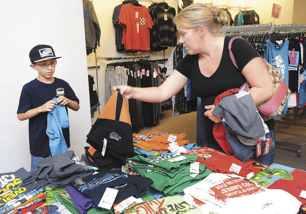 Nathan Egupov, 8, and his mother, Jennifer Egupov, look for back-to- school clothes Sunday at J.C. Penney in Valley Mall during the first day of Maryland's tax-free shopping week.
