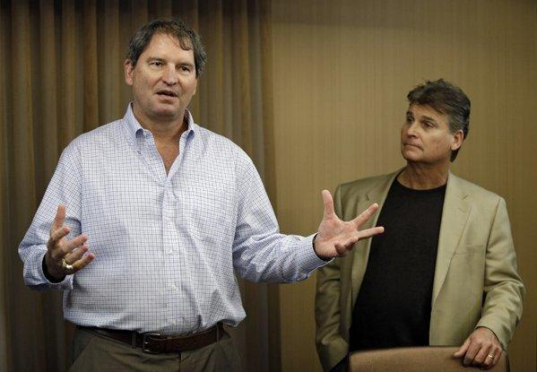 Former Cleveland Browns quarterback Bernie Kosar, left, during a news conference earlier this year.