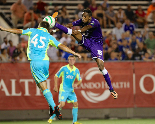 Orlando City's Dennis Chin tries to kick the ball as Cody Crook of the Seattle Sounders Reserves attempts a header during the Lions 2-0 victory. (Joe Petro, courtesy of Orlando City)