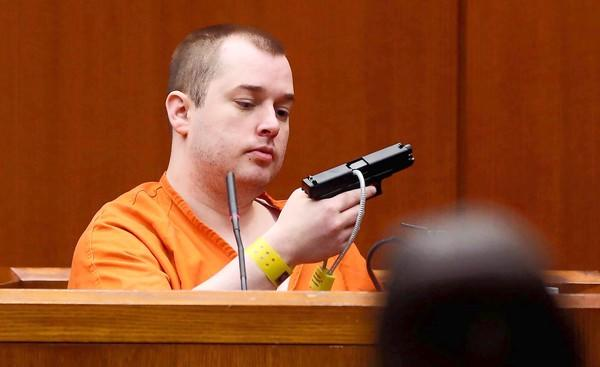 Gunman Jacob Nodarse holds the gun he used to kill three people. He was testifying in the trial of Johnny Borizov.