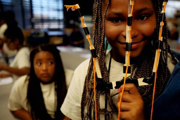 Courtney Shumate, 10, of Compton, is spending a week living at Cal State Long Beach, learning about college life and engineering. Twenty-nine girls participated in the program August 8, 2013, in Long Beach. During this workshop, the participants built prosthetic arms.