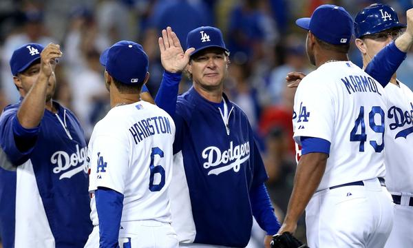 Dodgers Manager Don Mattingly, center, congratulates his players following Sunday's 8-2 win over the Tampa Bay Rays.