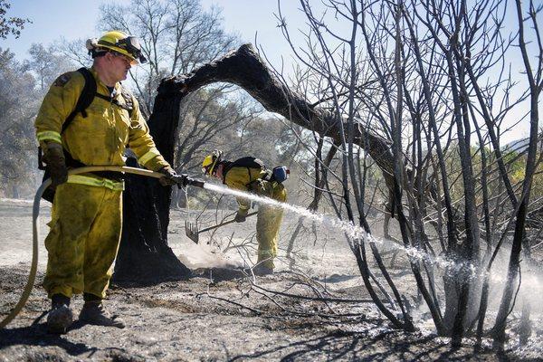 Cal Fire firefighters mop up hot spots near Twin Pines.