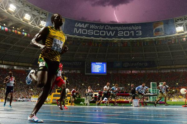 A bolt of lightning strikes just after Jamaican sprinter Usain Bolt wins the 100-meter title at the IAAF world championships in Moscow.