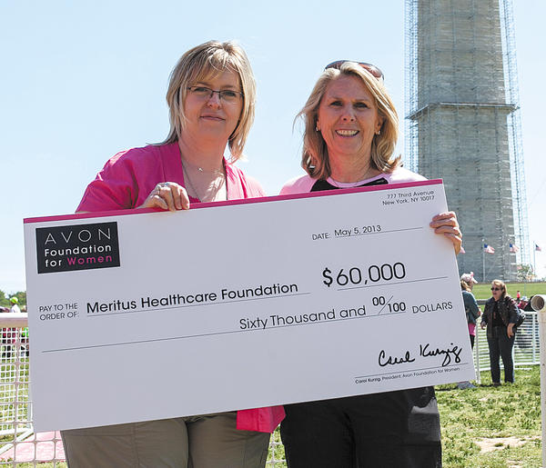 Carrie Starkey, left, of Meritus Health is shown with Avon Foundation for Women President Carol Kurzig, who presented a check for $60,000 to Meritus Health's Make a Difference Breast Cancer Screening Program through the Meritus Healthcare Foundation.
