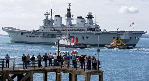 Britain's helicopter carrier Illustrious leaves Portsmouth navy base in southern England on Monday. British warships began setting sail for the Mediterranean for a naval exercise that will see one vessel dock in Gibraltar, amid tensions with Spain over the British-held territory.