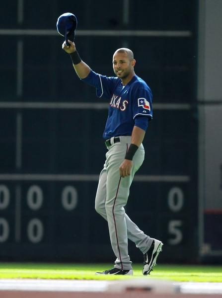 Alex Rios of the Texas Rangers waves his cap before a game against the Houston Astros on Saturday.