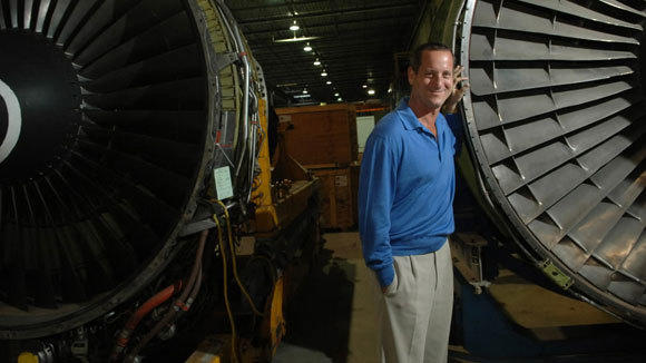 David Storch, CEO of AAR Corp., stands by large turbine engines in his warehouse in Wood Dale in July 2006.