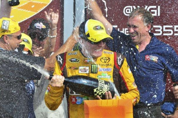 Kyle Busch celebrates his victory at Watkins Glen.