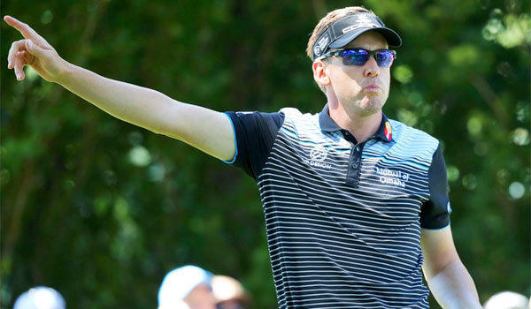 Ian Poulter signals after his tee shot on the 10th hole during the third round of the PGA Championship on Saturday.
