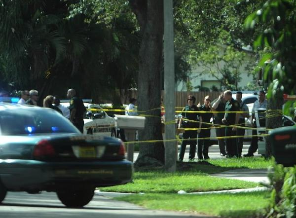 Investigators and deputies from the Broward Sheriff's Office at the scene of a deputy-involved shooting in Cooper City, Monday, Aug. 12, 2013.