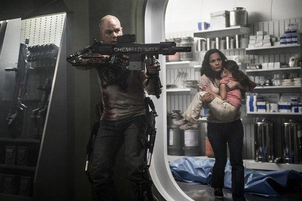 "Matt Damon, Alice Braga and Emma Tremblay in ""Elysium."""