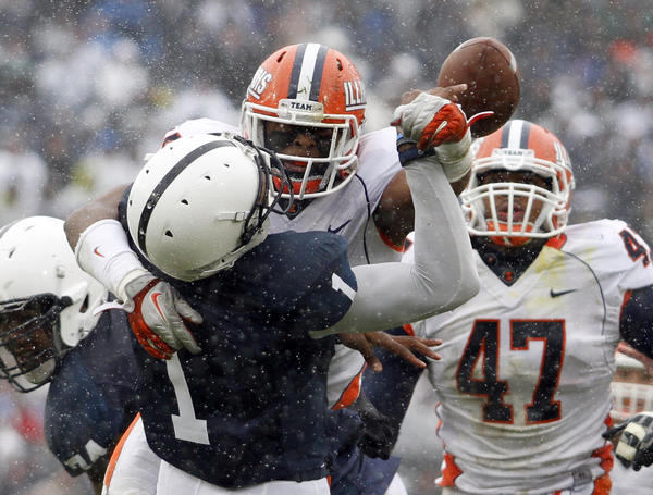 Jonathan Brown hits Rob Bolden of Penn State, causing a fumble during their 2011 game.