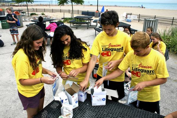 Left to right: Kelly Flanagan, Shea Martell, Simon Michalski, and Michael Kolovos put together first aid kits during the Wilmette Park District's junior lifeguard training camp.