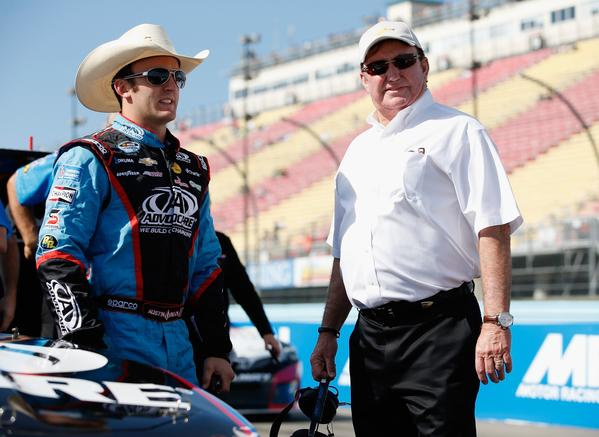 Austin Dillon, left, talks with his grandfather, NASCAR team owner Richard Childress, during qualifying for the Nationwide Series Zippo 200 on Saturday.