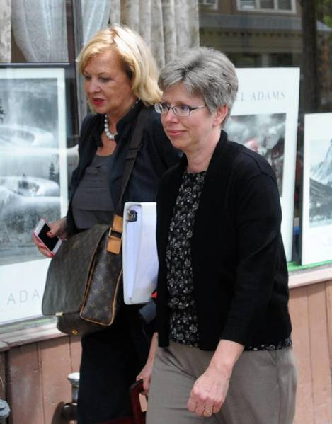 Barbara Mancini (right) of Philadelphia leaves the office of Magisterial District Judge James Reily in Pottsville after her preliminary hearing on an aiding suicide charge.