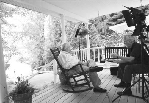 Ernie Mainland, nephew and namesake of Ernest Hemingway, talks about his famous uncle with producer George Colburn at Windemere, the family cottage on Walloon Lake.