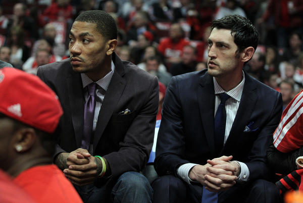 The Bulls' Derrick Rose and Kirk Hinrich watch from the bench during last season's playoff series vs. Miami.