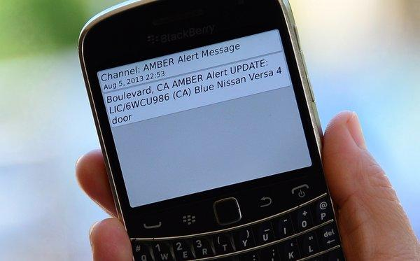 A cellphone displays the Amber Alert issued late on Aug. 5 in Los Angeles, which marked the first time officials have notified the public of a statewide Amber Alert through their cellphones.