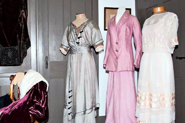 "Three dresses in the Salmon Brook Historical Society in Granby's exhibit ""The Downton Abbey Years."""