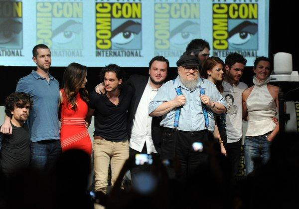 "George R.R. Martin, in suspenders, with the cast and writer-producers of ""Game of Thrones"" at 2013's Comic-Con."