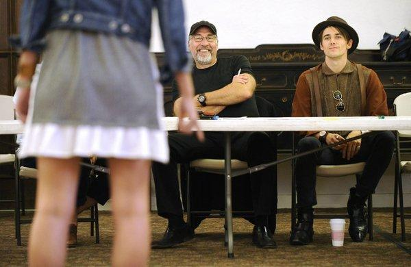 """Director Philip William McKinley, left, and actor Reeve Carney watch an audition for the Broadway musical """"Spider-Man: Turn Off the Dark"""" at the Hollywood Methodist Church in Los Angeles on Monday."""