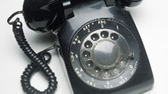 A file photo of a rotary telephone.