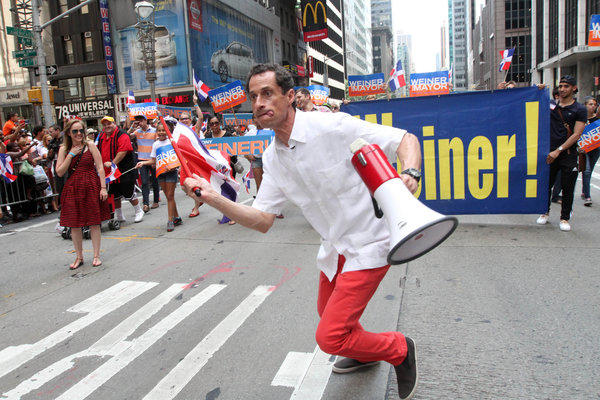 Anthony Weiner, running in New York's mayoral race, makes his way up New York's Avenue of the Americas as he takes part in the Dominican Day Parade on Sunday.