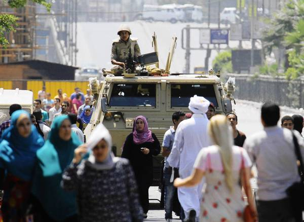 A soldier is deployed near Cairo's Nahda Square, where supporters of deposed Egyptian President Mohamed Morsi have set up camp to demand his reinstatement.