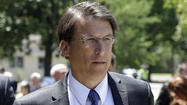 North Carolina's governor signs sweeping voter ID bill into law