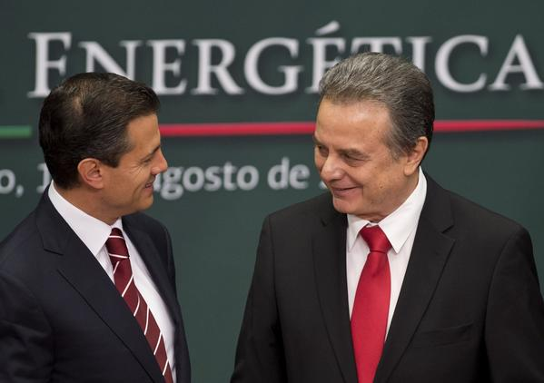 Mexican President Enrique Pena Nieto, left, talks with Energy Secretary Pedro Joaquin Coldwell in Mexico City.