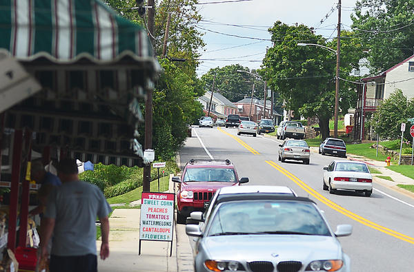 A design for an entrance into the Sycamore Run development in Boonsboro could reduce the number of parking spaces in front of Cronise Market Place along Alternate U.S. 40 in Boonsboro.