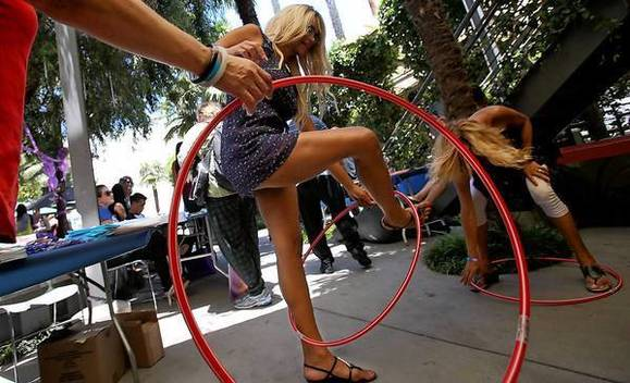 People compete in a Hula-Hoop contest at the 14th annual Trans Pride L.A. festival. A new bill of rights for transgender students in California is garnering widespread attention.