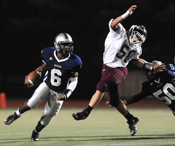 Dieruff's Shakur Lester (left) carries the ball against Lehighton last season.
